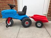 Kids ride on tractor with trailer