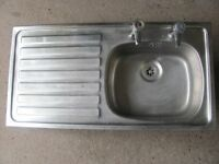 Staniless Steel Sink with single drainer and taps.