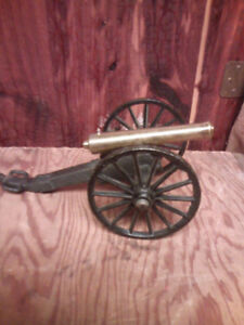 Vintage brass and cast cannon