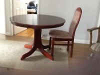 Dining Table and six chairs. Table converts from round to oval