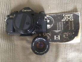 Canon A1 slr camera with canon 28mm lens, canon 50mm lens and case