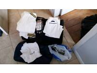 Cricket trousers, polo shirt, spikes, sweater, gloves