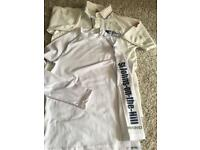 St Johns on The Hill cricket top (youth)and never worn skin (large youth