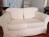 Off-white 2-seater sofa and matching armchair in great condition