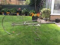Whimsical ornamental garden wheelbarrow