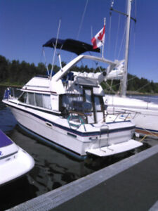**GIVEAWAY PRICE** 1988 BAYLINER FLYBRIDGE AND TRAILER