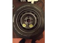 Brand new spare wheel and tyre
