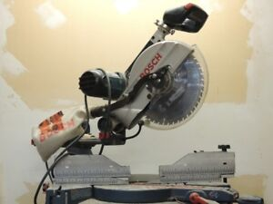 """12"""" Bosch Sliding miter saw with stand and blades"""