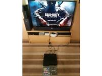 ps3 slim 120gb console with 2 games (no controllers)