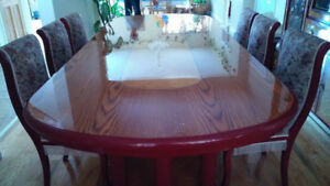 Grand dinning table for sale with 6 chairs and glass cabinet