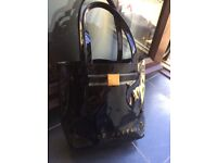 Ted Baker bag black with gold writing