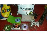 Playstation 1 in box with 4 games