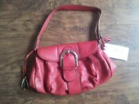 Tula red leather hand bag fully lined with labels. Cost £70 sell for £35.