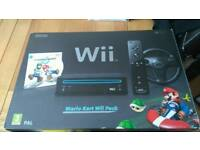 Nintendo with black Mario kart pack new in box