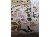 """Dunelm eyelet curtains with tie backs, green leaf design. 46"""" wide x 54"""" drop."""