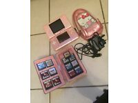 Pink Nintendo DS with accessories