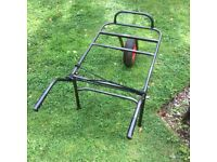Large wheelbarrow with removable front wheel.