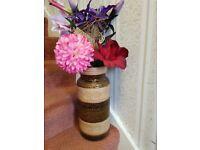 large indoor ornamental brown pot plus artificial flower display