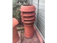 Pair of vented terracotta chimney pots