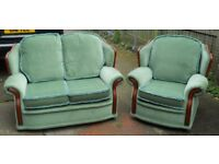 2 Piece suite 2 seater + Arm Chair Very clean condition reversible Cushions Green or floral