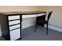 Black Ikea computer desk with side drawers and chair