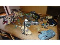 A selection of action toys for sale including helicopters, tanks and soldiers