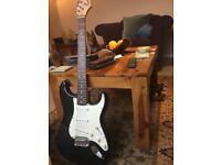 Unused electric Squier Fender Strat guitar