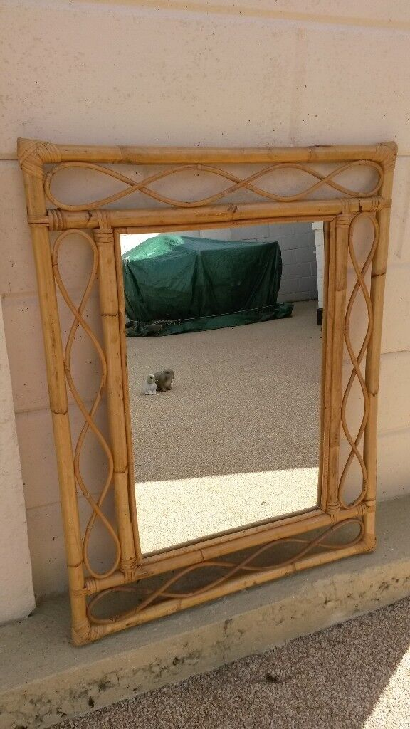 Cane framed glass mirror in very good condition (Hin Bournemouth, DorsetGumtree - Cane framed glass mirror in very good condition (H) 90 x 70 cm measurements are approximate. Any questions, just ask and I will get back to you asap. Please take a look at my other items for sale, thank you