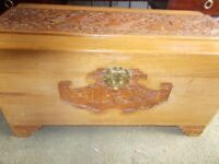 A CARVED CHINESE CAMPHORWOOD TRUNK
