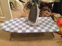 Iron and small tabletop ironing board