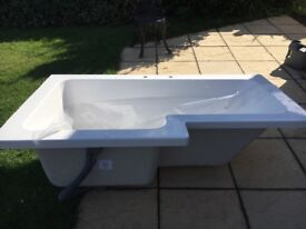 Left hand L shaped bath with side and end panel