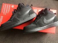 Brand new kids Nike high tops in black. Size 8.5