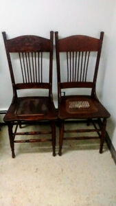 2 matching Antique highback chairs