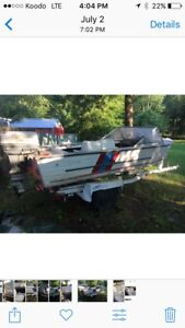 EZ load boat trailer and 15ft aluminum with a 40hp Johnson