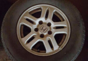 Four All Season Tires (With Rims)