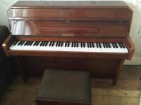 Zender walnut upright piano