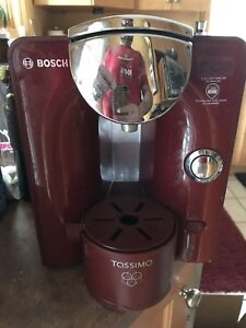 Red Bosch tassimo coffee and tea maker.