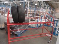 10 X 2 TIER PORTABLE TYRE RACK STEEL CONSTRUCTION WITH WHEELS THAT HAVE BRAKE.