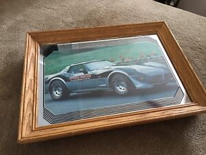 Framed Corvette mirrors and photos