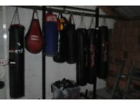 Selection of used boxing/punch bags for sale MMA weights gym fitness