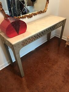 Marble top steel decor table.