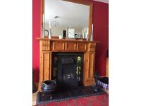 Pine Fire surround, Cast Iron insert with sunflower tiles. Hearth surround and grate.