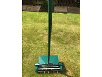 New Rolling Lawn Aerator