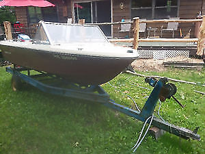 16 Foot boat with a 50 Evinrude outboard engine with trailer