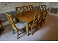 Housing Units Brisbane dining table in mango wood with 8 chairs. Extendable.