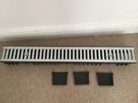 Low profile channel drain with galvanised grate and 3 end caps