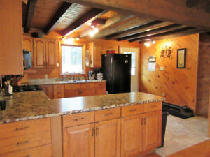 Log Home With Income Potential