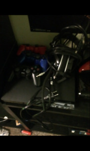 PS3, bunch of stuff with it. IN WHITECOURT