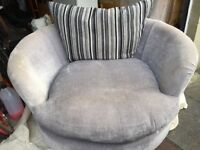 Grey swivel love seat in good condition