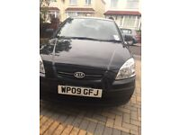 Black Kia Rio - 1 owner from new. Full service history.